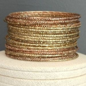 Jewelry - Bundle of thin textured metal bangles (26)
